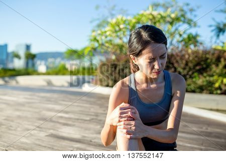 Woman with pain in knee joint sport workout