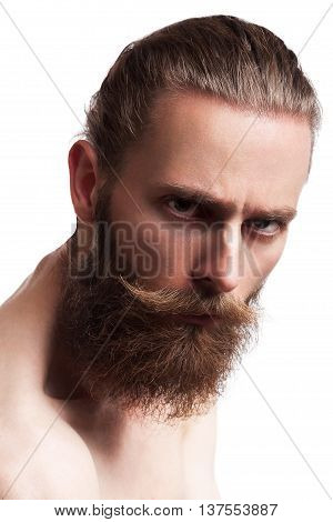 Cool looking hipster with long beard on white background in studio photo. Underground culture that became mainstream