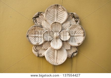 stone sculpture flower craft art design in wall
