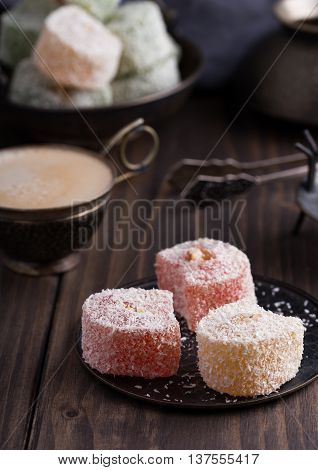 Traditional turkish delights on metal saucer with coffee