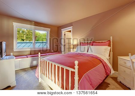 Adorable Girls Room With Pink Walls And Red Bedding.