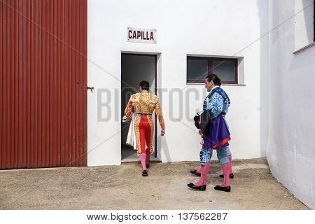 Pozoblanco Spain - September 23 2011: The Spanish Bullfighters enter chapel before starting bullfight tradition ancestral and religion in the world of bullfighting rite typical Spanish in Bullring of Pozoblanco Spain