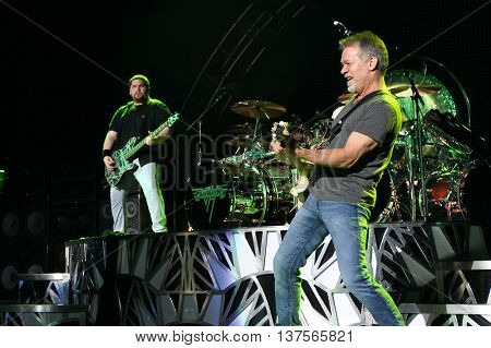 WANTAGH, NY-AUG 14: Eddie Van Halen (R) and son Wolfgang Van Halen of Van Halen perform onstage at Jones Beach Theater on August 14, 2015 in Wantagh, New York.