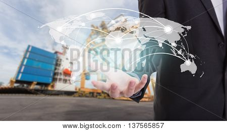 Global network coverage world map on hand of businessman. Industrial Container Cargo freight ship at habor for Logistic Import Export background (Elements of this image furnished by NASA)
