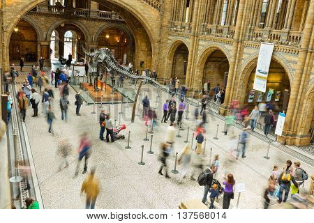 LONDON UK - APRIL 28 2013: Visitors in the main entrance hall at London's Natural History Museum. One of the Capitals most popular tourist attractions in April 2013.