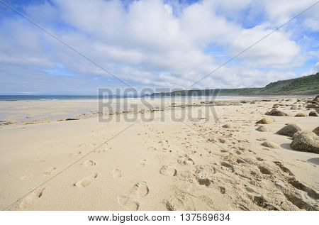 Large Empty Beach with footprints in Sand