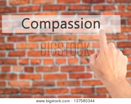 Compassion - Hand Pressing A Button On Blurred Background Concept On Visual Screen.