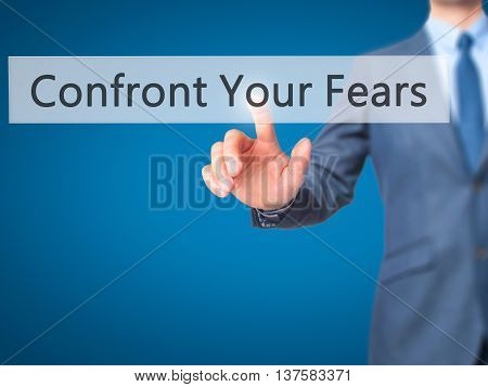 Confront Your Fears -  Businessman Click On Virtual Touchscreen.