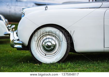 MINSK BELARUS - MAY 07 2016: Close-up of white Jaguar Mk VIII. This classic car was produced in the years 1956-1958. Vintage retro auto. Side view. Selective focus.