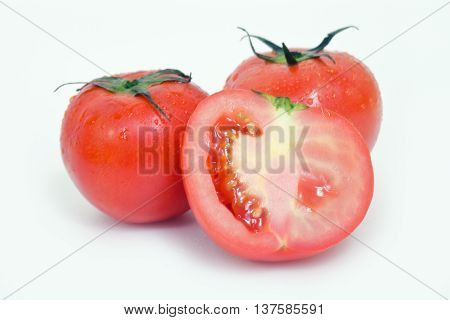 Tomato Fruit With Half Cross Section Isolated On White Background