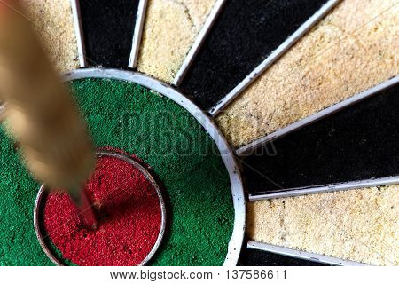 Dartboard With Steeldarts In Bullseye