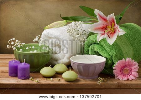 Spa concept still life with candles and towels