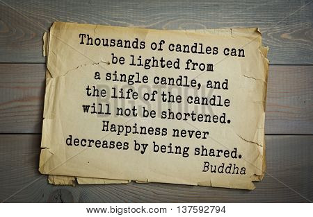 Buddha quote on old paper background. Thousands of candles can be lighted from a single candle, and the life of the candle will not be shortened. Happiness never decreases by being shared.