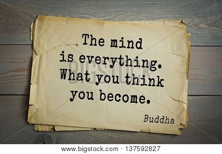 Buddha quote on old paper background. The mind is everything. What you think you become.