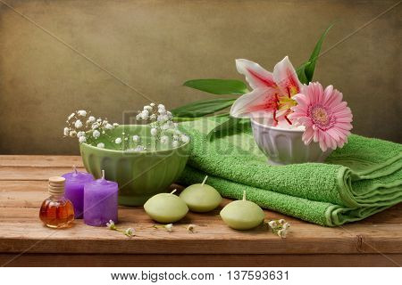 Spa concept still life with candles towels and flowers