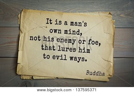 Buddha quote on old paper background.  It is a man's own mind, not his enemy or foe, that lures him to evil ways.