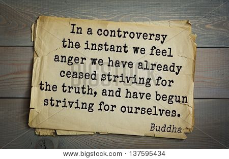 Buddha quote on old paper background. In a controversy the instant we feel anger we have already ceased striving for the truth, and have begun striving for ourselves.