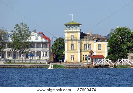 Cosy small resort town named Haapsalu in Estonia: view from sea in summer. ( A polar bear statue in water and Estonian flag on rooftop can be seen).
