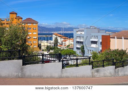 A view from uphill street in Gibraltar: buildings Bay of Algeciras and mountains in Spain.
