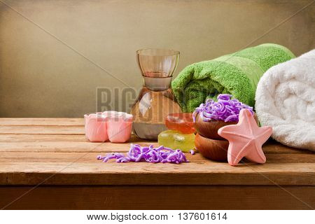 Spa still life setting with towels, aromatic oil