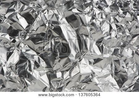Crumpled aluminum metal foil as a background