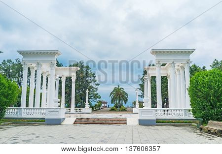The elegant white Greek-style colonnades serves as the entrance to the city beach Batumi Georgia.