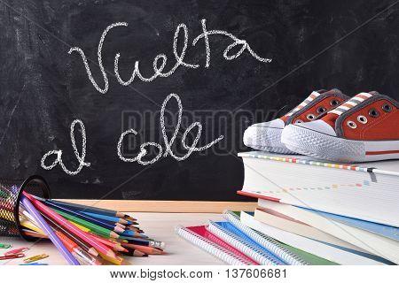 Vuelta Al Cole Written On Blackboard And Tools Front