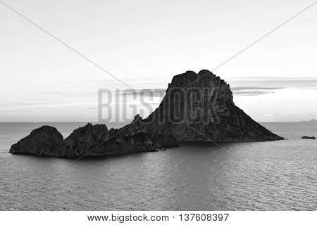 Es Vedra after the sunset, black and white toned image at the mystic rock of Es Vedra, Ibiza Island.