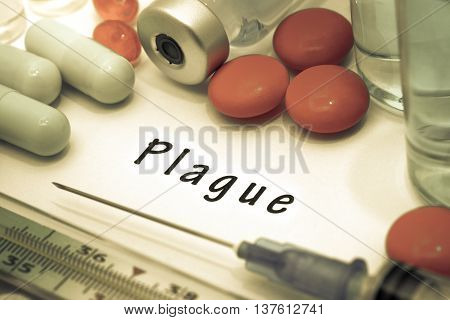 Plague - diagnosis written on a white piece of paper. Syringe and vaccine with drugs.