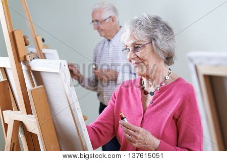 Seniors Couple Enjoying Oil Painting Class Together