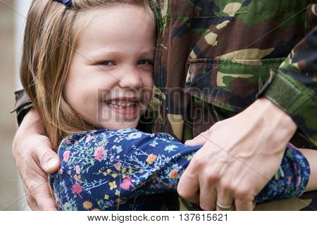 Daughter Hugging Military Father Home On Leave