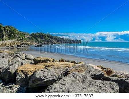 Coastal landscape with beach and rocks by the sea