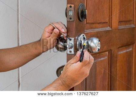 wood door and locksmith maintain silver knob