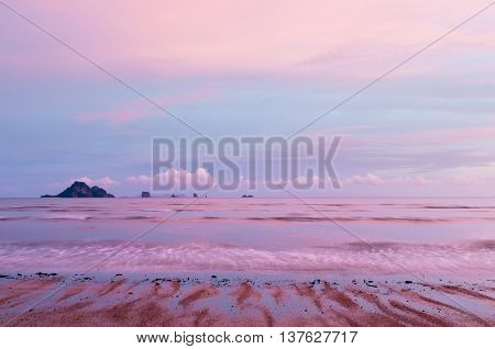 The landscape with the pink-blue sky and the pink-blue sea. Sunset sky, Thailand.