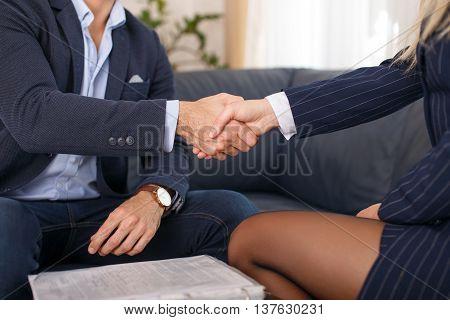 Businessman handshake with businesswoman indoor business  closeup