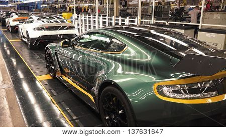 Gaydon England - December 10 2015: Assembly line in a factory of luxury sports cars.