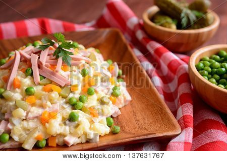 Mayonnaise salad with Bologna sausage, pea, onion, pickles and carrot