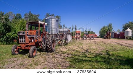 SASKATCHEWAN, CANADA - JUNE 30: Old farm equipment on June 30, 2016 in farm yard in Saskatchewan, Canada. Saskatchewan is a major agricultural producer in Canada.
