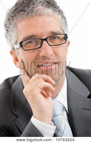 Closeup portrait of businessman with grey hair, wearing grey suit and glasses, thinking on something, smiling.?