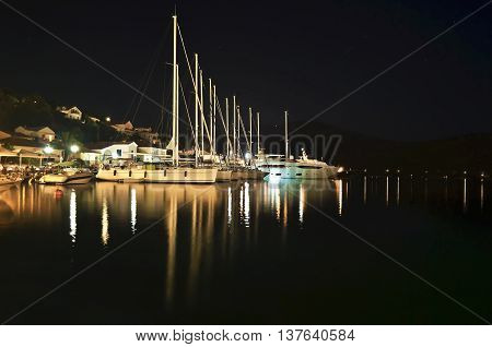 night photography of sailboats at Ithaca port Ionian islands Greece poster