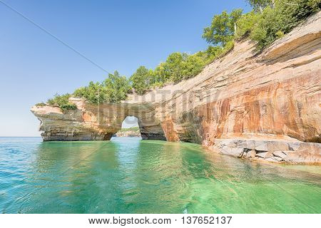 Lovers Leap a named formation on Lake Superior in Pictured Rocks National Lakeshore, near Munising, Michigan. Mineral seepage creates the colors: Red and orange are iron, green and blue are copper, black is manganese and white is lime.