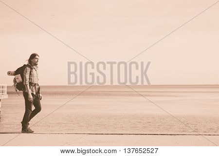 Man Hiker With Backpack Tramping By Seaside