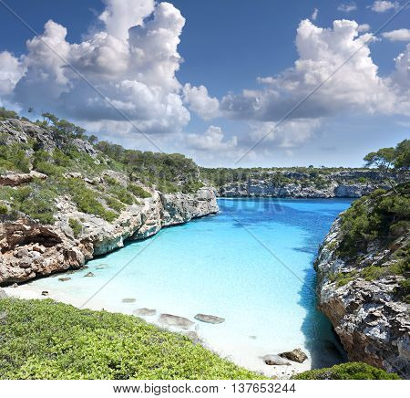 Beautiful turquoise clear water of mediterranean at Majorca beach Calo des Moro Spain