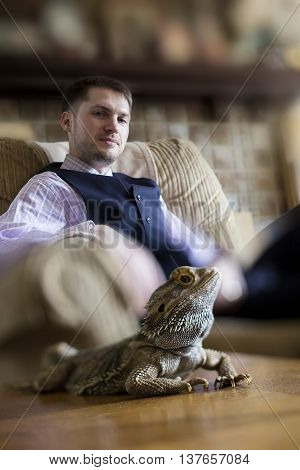 Pagona Bearded Dragon posing with male owner or zoologist