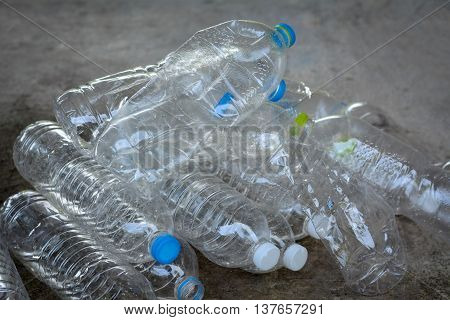 Plastic water bottles on cement floor.To be recycle