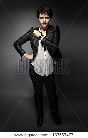 Fashion model wearing black goth style leather with stylish smartwatch or wrist watch