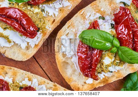 Bruschetta with dried tomatoes feta cheese and home made pesto