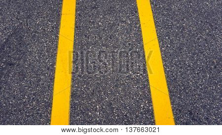 yellow line on street divided between car at parking lot