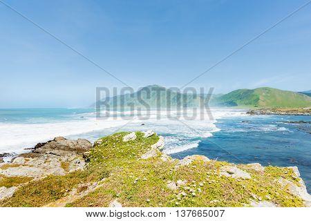 Coastal New Zealand long view land and sea Manurewa Point Wairarapa.