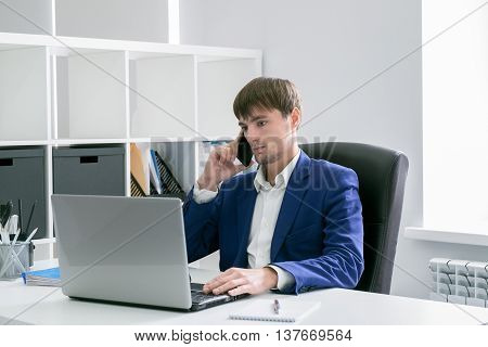 Man With A Laptop In The Office